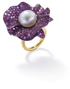 PHILLIPS : UK060111, , A cultured pearl, ruby and diamond flower ring