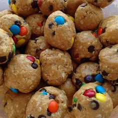 """Monster cookie protein balls: Mix 1 cup quick oats, 1/2 cup natural peanut butter, 1/4 cup honey, 1 scoop vanilla whey, mini m&ms and chocolate chips, roll together"""
