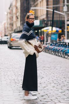 Jenna Lyons | J.Crew Exclusively for NET-A-PORTER striped cable turtleneck sweater | those are pants: cropped and wide-leg, not a skirt, but it is easy to pretend it is a long skirt