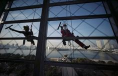 Photos of the day  December 21 2016Window cleaners dressed as...  Photos of the day  December 21 2016  Window cleaners dressed as Santa Claus and a reindeer pose for photographers while cleaning windows at a shopping mall in Tokyos Daiba bay area in Japan; armed police officers and soldiers of a frontier inspection station drill in the snow in Heihe Heilongjiang Province of China; flowers and candles are placed near the Christmas market in Berlin Germany after a truck plowed through a crowd…