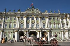Palace Square and the Hermitage Museum ~ Visitors can take a horse drawn carriage ride around the palace and former military buildings to get a full view of the architecture and beauty that is so unique to St. Petersburg. #StPetersburg #HorseDrawnCarriage