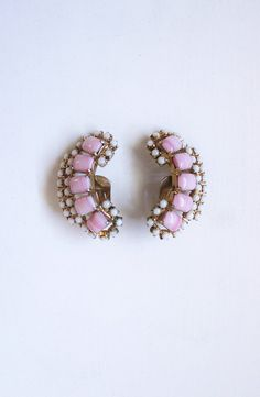 A personal favorite from my Etsy shop https://www.etsy.com/listing/545045919/ear-climbers-earrings-vintage-1950s-clip