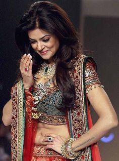 Sushmita Sen walks the ramp during the 'India International Jewellery Week' in Mumbai. #indian #celebrities #bollywood #fashion #style #lengha #saree #sari #blouse