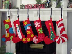 DIY Elfy-Felty Stockings. These won't hold the actual stuff from Santa, but I love how vivid and playful they are hanging on the mantel. And the elf toe shape.