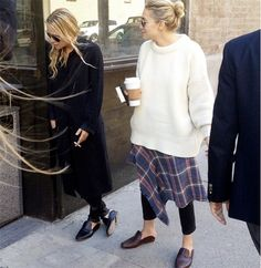 All about Ashley's sleek black coat and Mary-Kate's chunky sweater and plaid skirt. // Photo by @mduenasjacobs
