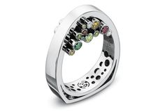 Inspired by an architect, this Erik Stewart platinum ring features tubes of varying lengths and colored diamonds. Winner of 2011 Johnson Matthey Sustainable Design Contest.