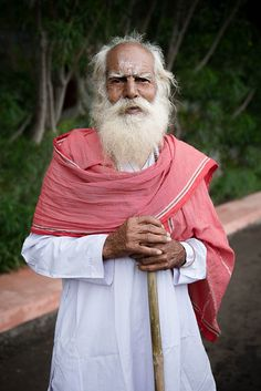 Old sadhu with walking stick attending Kumbh Mela in the city of Nasik. 75 million Hindu pilgrims attended the event, which is held once every 12 years.