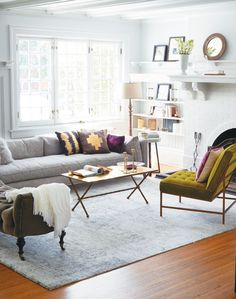 Arrange your furniture in small groupings to foster conversation, and think about a tufted bench for extra seating. #livingroom