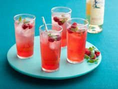 A refreshing rum Raspberry Lime Punch makes the perfect summer party drink.
