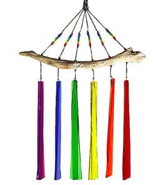 Handmade Fused Glass Windchime: Rainbow. Individually created with kiln-fired glass panels, the WindSpirit windchime captures the vibrant colors of the rainbow. Secured with durable nylon cording, the colorful glass dangles from natural beach-gathered driftwood. Unlike many metal versions, the glass panels create a light, tranquil harmony of chimes in the wind and catch the sunshine with a gorgeous color combination. This chime will add a colorful touch to any outdoor or indoor area!
