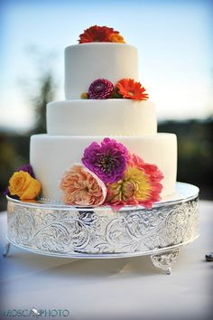 3 tier wedding cake with fresh #colorful flowers
