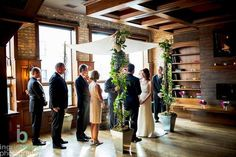 {{Naturalistic chuppah for a spring wedding at Revolution Brewing in Chicago.}}  Photography by Ingrid Bonne Photography, http://www.ingridbonnephotography.com/    Flowers by Pollen, pollenfloraldesign.com     Coordination by An Event Less Ordinary.