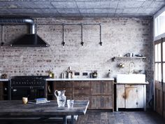 Honed marble and bronze fixtures contrast with the raw, unfinished brickwork - Hoxton Square Renovation Project