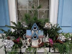 Birdhouses, greens and pine cones from the yard plus dried hydrangeas sprayed silver were added to the window box ornamental kale. A little bling for the holidays added the final touch. My window boxes are ready for winter! (Garden of Len & Barb Rosen)