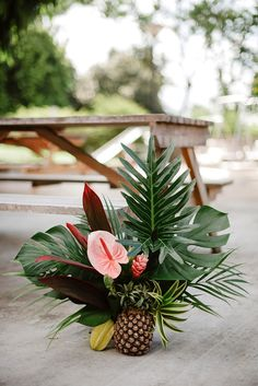 Beautiful floral and fruity tropical arrangement of pineapple, starfruit and lil. [ Beautiful floral and fruity tropical arrangement of pineapple, starfruit and lily // Today, we have just the thing to . Tropical Centerpieces, Tropical Flower Arrangements, Beach Wedding Centerpieces, Beach Wedding Reception, Tropical Flowers, Tropical Party Decorations, Beach Ceremony, Tropical Wedding Decor, Tropical Bridal Showers