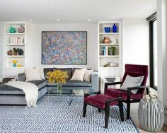 Living Room with Maroon Chair and Greek Key Rug