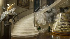 The Great Gatsby (2013) |The Grand Staircase in Gatsby's mansion as envisioned by production/costume designer Catherine Martin. Her inspiration was French decorator and furniture designer Emile-Jacques Ruhlmann