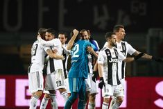 Juventus team celebrates victory after the Serie A football match TORINO -  JUVENTUS on at the Stadio Olimpico Grande Torino in Turin d953741a8
