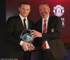 Wayne Rooney is presented with the Goal of the Season award by Brian McClair