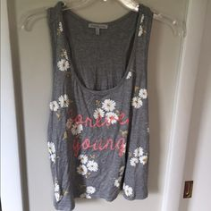 """Forever young crop top Loose flowy crop top with """"Forever Young"""" on the front and cute flowers. Never worn! Charlotte Russe Tops Crop Tops"""