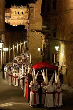 Holy Week in Salamanca, Spain:  Pictured is a penance procession in commemoration of the Passion of Christ.  The hat and mask of penitents pre-dates and is not related to the KKK.