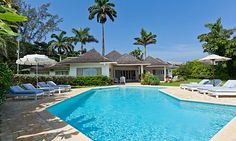 Right at the water's edge, Sunrise, a superior, 4 bedroom villa looks out over a private beach and the clear-blue shallows of the Caribbean Sea to a snorkeling reef and the indigo waters beyond.
