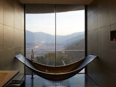 at the via vik an avant garde retreat and wine spa in millahue chile a carbon fiber bathtub suspended from the ceiling is strategically positioned for ceiling avant garde