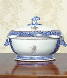 A CHINESE EXPORT PORCELAIN ARMORIAL SOUP TUREEN AND COVER  QIANLONG, CIRCA 1785  With boars-head handles and leaf frond finial, the crest a rising hawk above an urn bearing the intials G.J.R. flanked by pink ribbons with the motto MORS VEL VICTORIA, all within a gilt chain and Fitzhugh borders in underglaze blue  13 in. (33 cm.) wide (2)