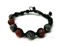 Two Tone Black & Red Shamballa 10mm Glass Beaded Macrame Bracelet with 7 Alternating Iced Out Disco Balls JOTW. $9.95. Great Quality Jewelry!. 100% Satisfaction Guaranteed!. Unique adjustable pull string cobra stitched lanyard design.