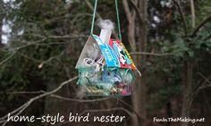 a bird nester because it is like a bird feeder but with nesting materials instead of bird seeds.