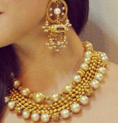 Multiple layer of gold beaded chains stringed between two layer of big bold pearls. This double layer pearl choker necklace set design will compliment both traditional and modern outfits. Indian Wedding Jewelry, Bridal Jewelry, Jewelry Gifts, Beaded Jewelry, Bohemian Jewelry, Bridal Necklace, Indian Bridal, Pearl Jewelry, Pearl Choker Necklace