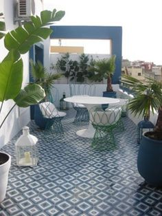 55 Awesome Morocco-Style Patio Designs : 55 Charming Morocco Style Patio Designs With White Blue Wall Table Chair Plant Decor Ceramic Floor Candle Pots And Outdoor View