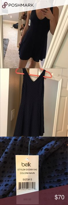 Navy Dress-Never Worn! New with Tags This dress hugs the waist and then flows out to give a nice hourglass shape! It can be dressed up or down with different shoes/jewelry. It has never been worn and still has its tags! belk Dresses Mini