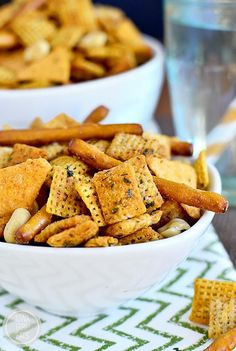 Buffalo Cheddar-Ranch Chex Mix is a party in a bowl! This gluten-free snack mix takes just 4 minutes to cook and has the perfect amount of spice. #snack | iowagirleats.com