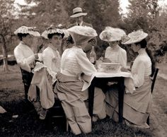 A Bygone Era - the ladies picnic. I LOVE this picture! It looks like there may be triplets at the table. They all look like they could possibly be sisters...and maybe a brother thrown in?