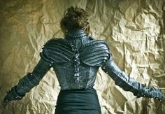 Did you ever find yourself wondering what Joan of Arc would have worn if she lived in modern times and rode a bicycle instead of a steed? Well, Grace Duval obviously did and she came up with an awe-inspiring upper-body armor made entirely of paper mache and bicycle inner tubes.
