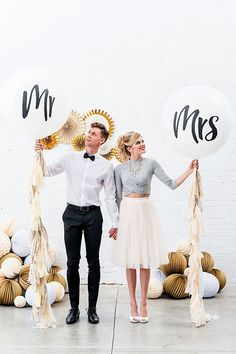 These Mr. and Mrs. balloons make for fun wedding props! | Jumbo White Round Mr. and Mrs. Balloons | David's Bridal | Wedding Balloons | Wedding Portrait Ideas | Reception Decor | Photo Booth Props | Reception Ideas | #balloons #weddingideas