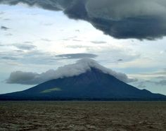This photo shows a cap cloud clinging to the cone of Concepcion Volcano was taken from a ferry in Lake Nicaragua, Nicaragua. Concepcion Volcano is an active stratovolcano standing approximately 1 mi (1,610 m) above the lake's surface. It has erupted 25 times in the past 130 years. The Concepcion and Maderas Volcanoes comprise the dumbbell shaped Ometepe Island, situated near the center of Lake Nicaragua. Photo taken on October 12, 2012.