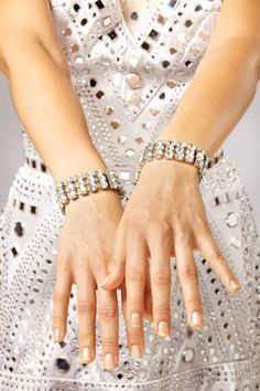 """The """"Mirror"""" costume was designed by Gregg Barnes and was introduced by the Rockettes in 2003. #rockettes #NYC #costumes #dancers #glamorous #white  #silver #sparkle #mirror #hands #nails #jewelry"""