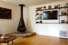 Wall mounted entertainment shelving.  Sean & Sara's Minimal Americana House Tour | Apartment Therapy
