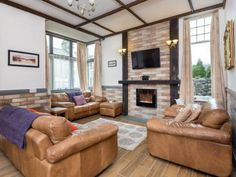 The beautiful sitting room with stunning views at Wren Cottage in Keswick. Lake District Holidays, Lake District Cottages, Stunning View, Beautiful, Wren, Game Room, Couch, Patio, Bedroom