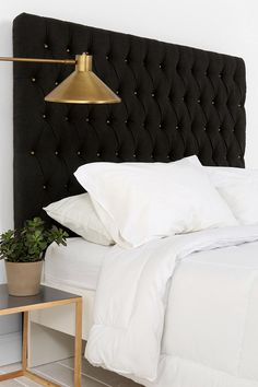 Tufted black headboard + brass