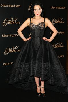 Dita Von Teese at her lingerie collection launch at Bloomingdale's. I want that dress and bra combo so, so bad.