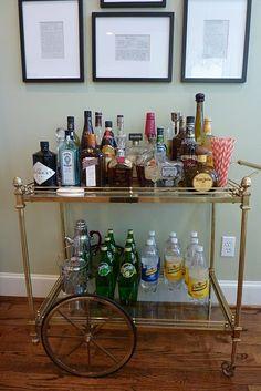 Vintage bar cart. Love the wall art, too!