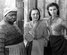 1939: Actresses Vivien Leigh, Olivia de Havilland and Hattie McDaniel play the roles of Scarlett O'Hara, Melanie Hamilton and Mammy respectively in a scene from the movie <i>Gone with the Wind</i> by Victor Fleming. (Photo by Mondadori Portfolio via Getty Images)
