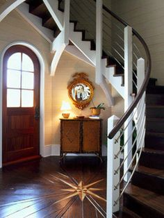 Check out the woodwork in the floor. #RoundTopDoor #WindingStaircase  intersting way to to put the stairs
