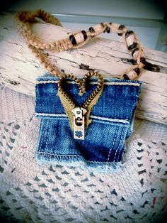 This is a Lucky Charm Denim Pouches necklace. This upcycled necklace was made using a tiny denim pocket, a zipper and a hemp style beaded necklace. This is a great way to carry your lucky charms, crystals, coins or whatever little goodies you need a safe spot for. Coming soon to my Etsy shop!