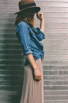 Long skirt, tied up denim shirt, boots.