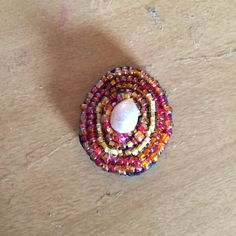 Broach  made with pearl bead seed beads and felt .