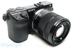 I'm intrigued by these mirrorless cameras. Priced between DSLRs and compact cameras. You can change lenses, but the body is super small. And they have large sensors. And shoot video. Hmmm...